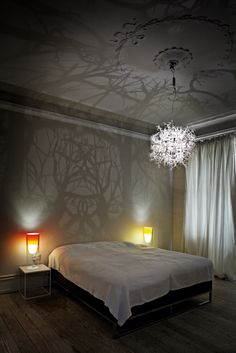 A light sculpture that turns the room into a tangle of branches and trees.