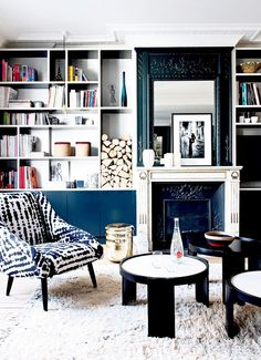striking black & white Parisian living room with fireplace