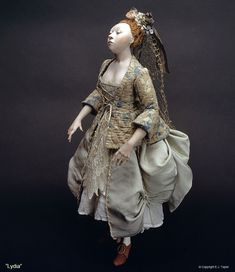 Doll by EJ Taylor. You must look through his gallery.  This is a prime example of doll-making as an art-form.