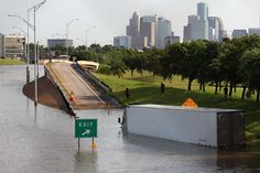 A tractor trailer is seen with the Houston Skyline in the background in the flood waters on 288 and McGregor in the Medical Center on Tuesday, May 26, 2015 in Houston. Photo: Thomas B. Shea, For The Chronicle / © 2015 Thomas B. Shea
