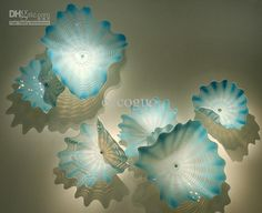 Cheap Wedding Decorative Glass Plate Wall Art Online with $115.1/Piece on Eccoguo's Store | DHgate.com$1233.51 for ten+ pieces at http://www.dhgate.com/store/product/cheap-wedding-decorative-glass-plate-wall/158306260.html