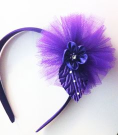 """Item: Purple Tulle flower headband Size of Tulle Flower measures: 3"""" diameter These tulle flower headbands are great little hair pieces for girls to wear to match any pettiskirt, tutu, or outfit. Perfect for birthday girls! These can also be used as great party favors or use them to wear in honor or Rely for Life Awareness in March."""