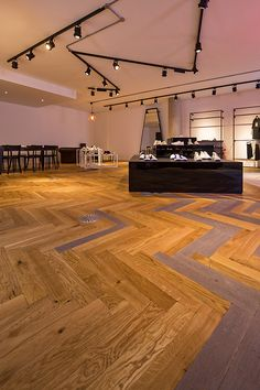 Bespoke Multicoloured Oak Parquet Flooring by Broadleaf - choose the colours you want and mix them to create your own unique design, An ideal wood flooring choice for restaurants, bars and other commercial spaces. Please call 01269 851 910 for more information.