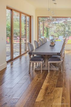 Wide Plank Hand Scraped Hickory Hardwood Floor By Oak And Broad | Dining Area With Huge Farm Table And Floor To Ceiling Windows | Discover more at http://OakAndBroad.com/custom-hand-scraped-hickory-floor-cupertino/