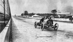 Louis Disbrow streaks past the camera during qualifying.  Indy 500, 1913.