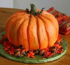 Pumpkin cake made by putting two bundt cakes together. Either decorate with orange-colored cream cheese frosting as shown here (an inverted cupcake can be the stem) or ice with mocha whipped cream. Cut in layers like a wedding cake to serve a crowd. Yum!
