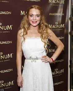 Angelic: Lindsay's white dress managed to remain pristine despite her icecream making