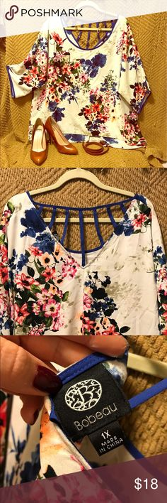 Floral birdcage back top This lightweight flowy top is ideal for spring and summer. The birdcage back and smooth flowing floral cut gives it a boho chic feel.  Bundle it with items pictured and receive a discount! (All items pictured are for sale and listed separately) Tops Blouses