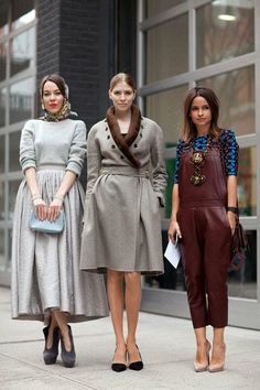chorus of show stopping outfits X 3 - cue fifties inspired ensemble: grey pattern head scraf, silver-grey light wool sweater, silver-grey high waist full midi skirt, charcoal-grey suede high heel wing-back statement pumps, pearl-grey clutch ... award winning