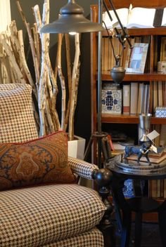 """""""What's better than one men's wear pattern in winter? Two, paired together. This yummy paisley is sublime with this hound's tooth check chair. The color interplay is just perfect."""" --Nell Hill's Blog"""