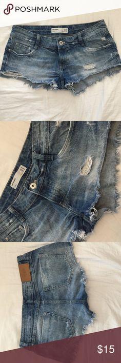 "Zara Distressed Denim Cutoffs ▫️No trades ▪️No free shipping  ZARA / Denim Distressed shorts cutoffs / Great Condition! / ▫️Price is firm  Retail: $40  Size US 04 / MEX 26 / EUR 34  Laying flat: Across waist 14.5"" Side seam rise 8.0""  Tags: black shorts black denim shorts white shorts white denim shorts denim skirt white skirt black skirt leather skirt metallic shorts skirt Distressed shorts Pencil skirts bodycon skirt Zara Shorts Jean Shorts"
