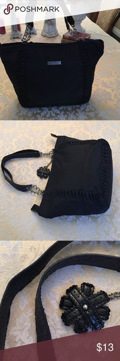 """GUC Black nylon Jessica Simpson bag I loved this bag and used so very lightly worn on the strap edges (see pic 3), but in overall good condition! Measures 10"""" x 16"""" with a bottom span of 5"""" and at strap drop of 9"""". Adorable faux patent flower on chain is detachable but who would take it off? It's so cute! Roomy interior with cell phone pockets, 1 zippered pocket and key fob. Jessica Simpson Bags"""