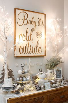 Pretty farmhouse style dining room Christmas decorations. Dressed in whites and metallics for that magical Christmas glow!