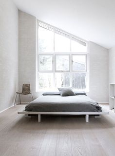 beautiful angle window in the bedroom - minimal decor - Norm Architects