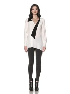 Silk Lapel Blouse. Smooth lightweight silk with two-toned lapels, inset chest pocket, hidden snap closure, padded shoulders, double-button cuffs