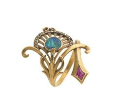 Peacock feather ring by Georges Fouquet c1908 Pinned from Mari Carmen Bermudez Dominguez