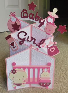 Handmade baby girl cascade card. Cuttlebug swirls. Baby steps cricut cartridge.