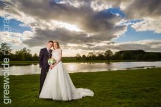 Dramatic sky in this evening portrait by the lake at Somerford Hall, Staffordshire Wedding Photography, Sky, Portrait, Wedding Dresses, Heaven, Bride Dresses, Bridal Gowns, Headshot Photography, Heavens