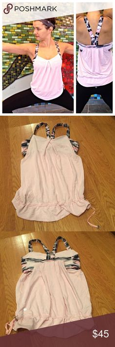 Lululemon rest less tank! Camo pink! SIZE 8 Worn once camo pink rest less tank size 8. Flowy style on bottom with great support on to. Drawstring at bottom to cinch. SIZE 8. Inside tag attached lululemon athletica Tops Tank Tops