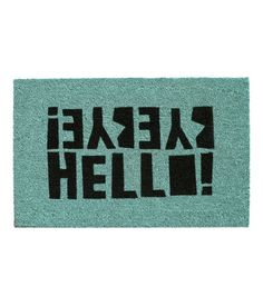 Coir doormat with a printed motif and latex backing. Size 18 x 28 in.