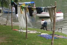 Woman with Drying Laundry - Along Shore of Lake Bosumtwe - Ghana