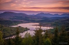 The sun sets over Loch Garry in the Highlands of Scotland.