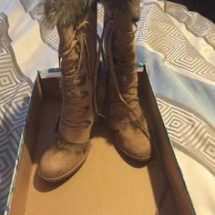 Tan furry boots Excellent condition. Super cute for the winter Shoes Heeled Boots