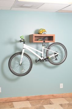 Handmade Wooden Bike Rack & Shelf - This unique architectural bike rack is hand crafted out of mahogany. It is beautiful with and without your bike docked in it. This piece also doubles as a shelf for displaying your favorite items. Perfect for the outdoo Wood Bike Rack, Diy Bike Rack, Bike Hanger, Bicycle Rack, Indoor Bike Storage, Bicycle Storage, Indoor Bike Rack, Ideas Cabaña, Bike Wall Mount