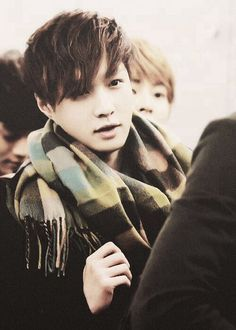 Lay.. He looks bundled up for fall. Get the look. O wait u can't cuz ur not a unicorn XD