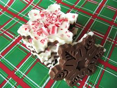 Snowflake Peppermint Bark - Baked by Rachel  Pour melted chocolate into a cookie cutter on a tray and then put peppermint sticks or sprinkles on top! Let sit until it's ready