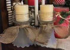 My candle stick holders I made from old ceiling fan globes and mason jars...added a little burlap and that's all!!! Love me some candle stick holders!DIY!