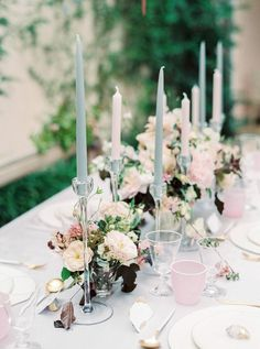 small floral arrangements with long taper candles