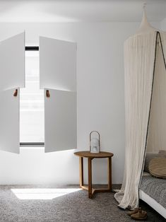 Bedroom with interior window shutters. Est Magazine issue 28 (Design by Alexander & Co, styling by Claire Delmar, photo by Felix Forest)