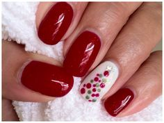 CND shellac in ruby ritz with xmas tree on accent nail