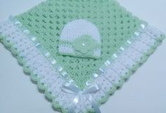 """This beautiful hand crocheted granny square baby blanket is made of 100% baby soft yarn. It is made out of a very good high quality yarn. Very soft and colorful blanket set. Beautiful hand crochet baby blanket and baby beanie hat in light green and white colors. White satin ribbon woven in edge of blanket. Beanie hat has a beautiful crocheted flower and flat pearl button. Makes an EXCELLENT baby shower GIFT! It measures at about 34"""" inches by 34"""" inches square...perfect stroll..."""