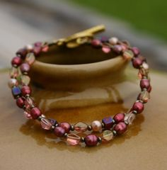 Im crazy about these colors!!  Double Strand Bracelet Wine & Rust Pearl and by InspiredTheory, $13.00