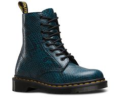 All the history of the original, iconic 8-eye 1460—updated with a digital, textured snakeskin print. Ready for a miniskirt, tights and some blood-red lips, this Pascal is a fashion-forward nod to punk with an irreverent edge. The Viper Pascal is all original, tough Dr. Martens craftsmanship, with the signature AirWair bouncing sole for durability and comfort. It's Goodyear-welted, meaning the upper and sole are sewn together in our heat-sealed yellow z-welt stitch. Viper is a fashion leather…