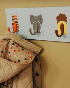 """Decorate a baby's nursery with this wildly adorable coat rack, seen on """"The Martha Stewart Show."""" To add texture, like fur, to your creatures, apply paint over the base coat using a stippling brush."""