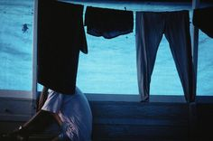BRAZIL. Tarpaulins on boats on the Amazon fend off the rain but raise the temperature for passengers. 1993.