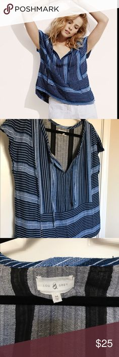 Lou & Grey Baja Top Hoodie style pocket in the front. Drawstring closure around the neck area. It's a medium top, but for some, it may fit like a large. Vertical stripes. Lou & Grey Tops Blouses