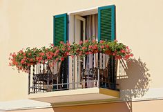 balcony shutters just adds to anotherwise flat wall