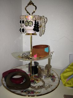 Home made cake stands used for jewelry. Plates from op shops!