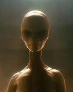 """From most accounts by alien """"abductees"""", they show less expression than this.  They communicate telepathically and through their eyes more than the mouth.  Not saying that's how it actually is, that's just what most say."""