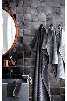 H & M and black zellige tiles make a perfect towel (tile) ad!
