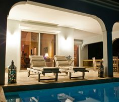 Meads Bay Beach Villas Outdoor Lounge Chairs and Pool At Night, ranked #1 on Trip Advisor!