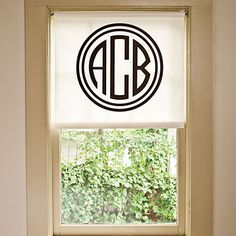 Love this roller shade with a monogram!