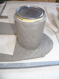 use the clay wrapped can as a template for the bottom of the mug