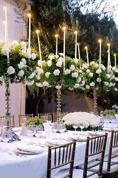 This is super fancy, but an idea of integrating vintage glassware with flowers and candles