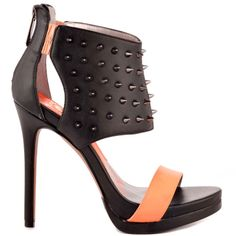 Wreak havoc in the edgy Raina from Circus by Sam Edelman.  This bold style features a spiky man made upper with elastic details and back zipper for the perfect fit.  A neon strap, 5 inch heel and 1 inch platform tie up this sleek style.