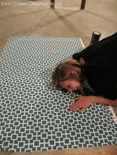 Great way to get the colors and style you want. Make your own rug out of a rubber floor mat and fabric of your choice.